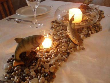 a river bed running right down this dinner table - complete with resin fish. A perfect table design for an avid fisherman.