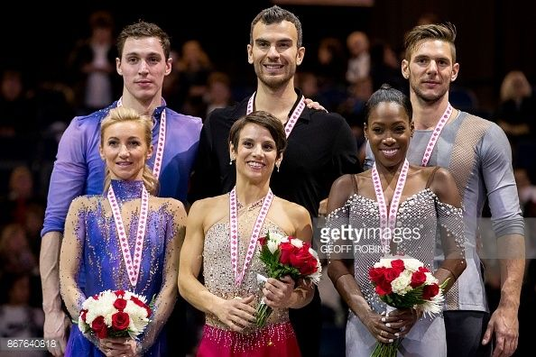 Pairs gold medalists Meagan Duhamel and Eric Radford of Canada pose with Silver medalists Aliona Savchenko and Bruno Massot of Germany and bronze medalists Vanessa James and Morgan Cipres of France...