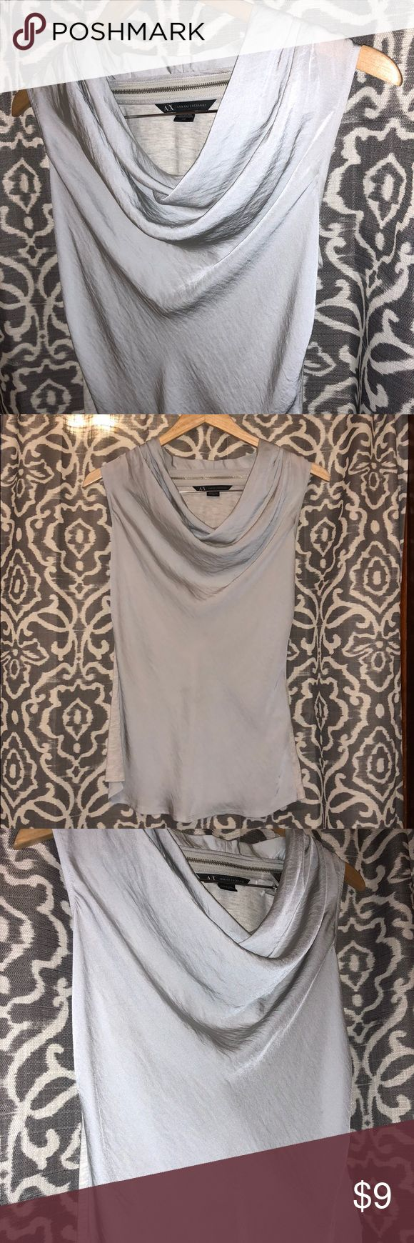 Armani Exchange Cowl Neck Top A/X Armani Exchange shimmering look cowl neck top. Light gray/silver front with marled look light gray/white at back. Back of neckline has decorative zipper hardware. Worn once. Like new condition. Size small. A/X Armani Exchange Tops