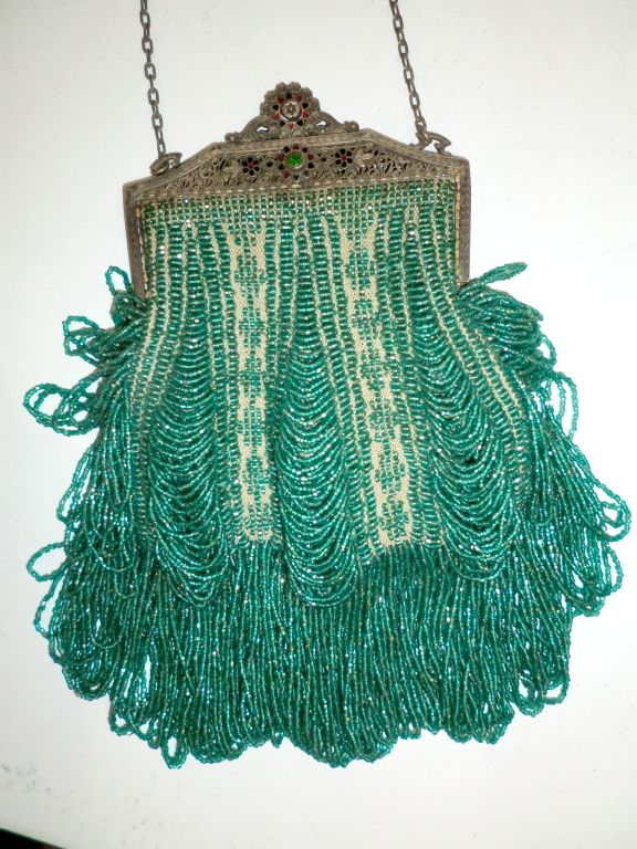 1920's Beaded bag - https://www.1stdibs.com/fashion/accessories/handbags-purses/1920s-beaded-frame-evening-bag-turquoise-beads/id-v_69403/