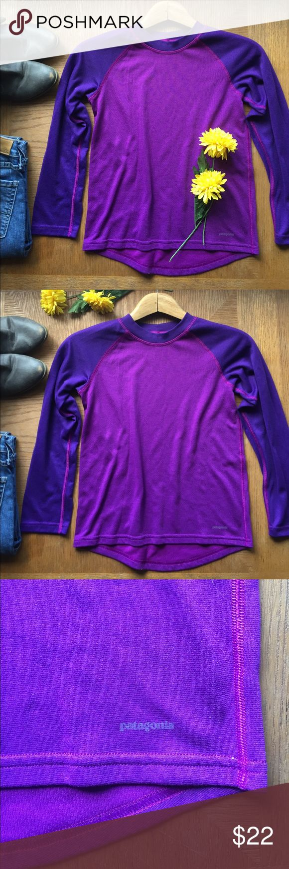 Patagonia Capilene 3 Midweight Base Top Patagonia Capilene 3 Midweight purple long sleeve top.  Slight high low top.  In great condition. Patagonia Shirts & Tops