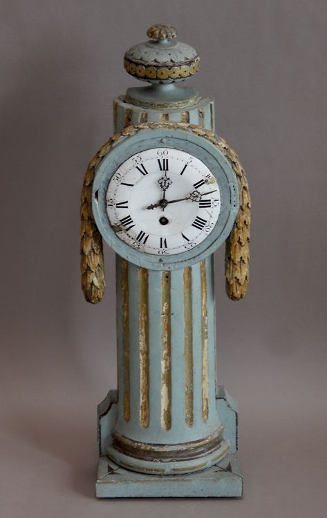 """Swedish mantel clock in the Louis XVI style, circa 1800. Clockworks are mounted in an open-backed column with carved swag and urn. Original painted surface and clockworks.  H:30"""", W:10"""", D:5"""".  Ref. #03-02"""