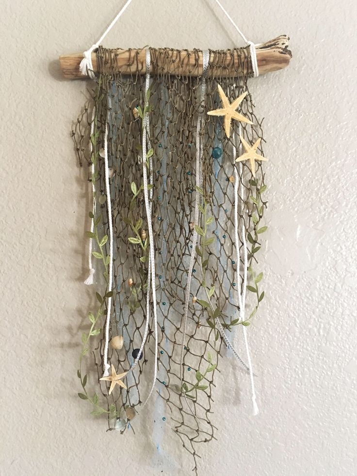 Wall decor / beach wall hanging / dream branch / dream catcher / sea shell decor / beach decor / beachy boho wall hanging by JzBabies on Etsy https://www.etsy.com/listing/517668576/wall-decor-beach-wall-hanging-dream