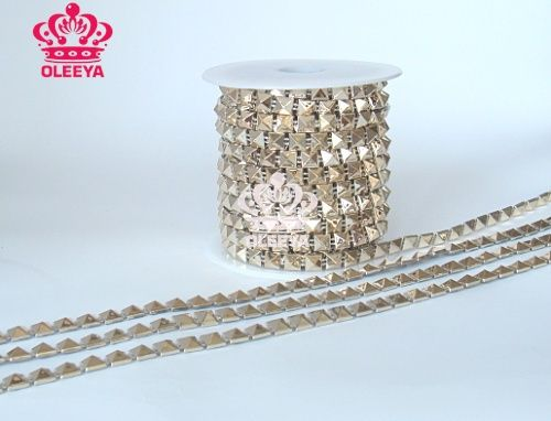 Find More Garment Rivets Information about New 2013 20yards/roll Rock Punk Gold Spikes Studs Revit Chain Tapered Square Trimming Garment Decoration for Bags,Shoes,Belts,High Quality decorative heels,China new christmas decoration Suppliers, Cheap garment accessories from OLeeya Rhinestones ( High quality ) on Aliexpress.com