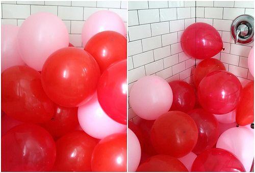 shower full of balloons.