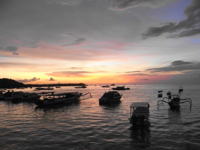 Local fisherman's boats awaiting their next journey. Sunset at Nusa Lembongan.