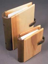 Wood books by Nigel Lucraft. A trained furniture maker, Nigel has been self employed since 1990. From his workshop in Devon he has developed a unique and extensive range of desk top accessories in English and North American hardwoods. The wooden covered address books and the beautiful burr wood veneered photo albums, complemented with hand dyed leather spines, are the most popular items within the range.