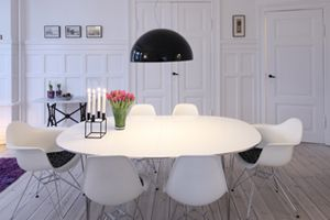 Danish dining room. White oval dining table with Eames Eiffel chairs.