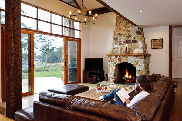 Take it easy next to a gorgeous fire in the large open stone fireplace, Adventure Bay Retreat, Bruny Island.