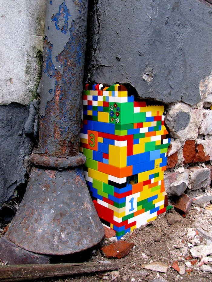 """These LEGO street art shows us how LEGO plays a part in our lifestyle, or rather this artist's life. This artist is using LEGO in his piece to tell us a statement about """"rebuilding the world with LEGO"""". Lego has become a lifestyle brand. Congrats LEGO, free advertising for you."""