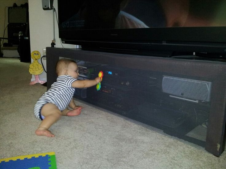 Baby Proofing the entertainment center: window screen material and industrial Velcro
