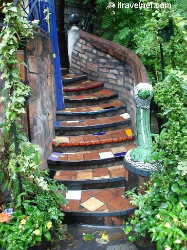 I am loving tiles stairs - I am thinking about tiling some down to my back garden but am scared they might be too slippery...a bit like these.