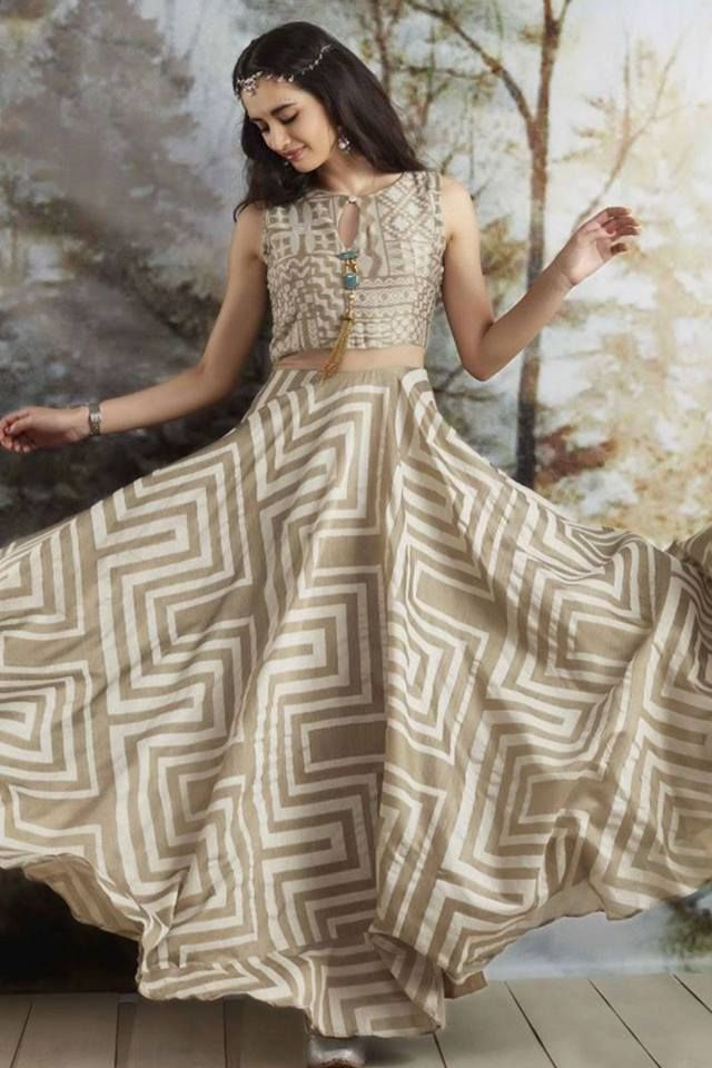 Get the ethereal feel in this earthen ivory & beige-grey suit with a generous geometric printed flare. Buy Indian Suits online - http://www.aishwaryadesignstudio.com/classy-ivory-suit-with-geometrical-print