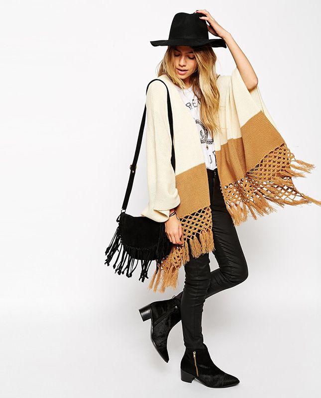 Bundle up in a cozy fringe cape.