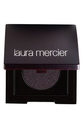 This lovely product is the Tightline eyeliner from Laura Mercier. While you do have to apply with a wet brush (and it does take some practice), it will stay on forever! Well, not literally forever, but I have slept with it on and it stayed in place!