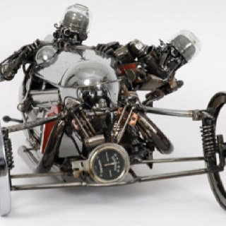 The Australian artist James Corbett,  46-year-old creates these sculptures using salvaged old car parts.  Each item was fabricated from junk using 1950 and 1960 automobile parts.