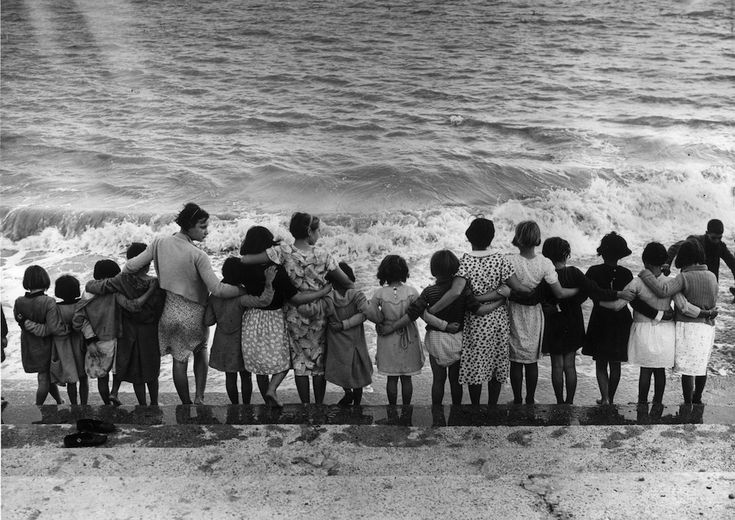 A group of Basque children, refugees from the Spanish Civil War, standing on the sea front at St Mary's Bay Holiday Camp, New Romney, UK, in 1937. (Reg Speller/Fox Photos/Getty Images)