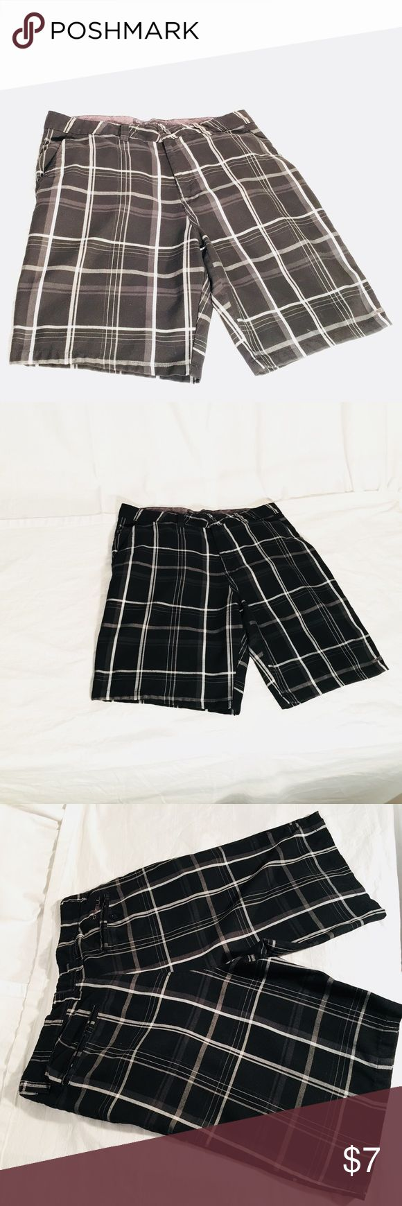 Men's Plaid shorts O'Neill Plaid Black andWhite shorts mimic the cut of swim trunks, have subtle side pockets with room like a cargo short, and the finished upper like a pair of slacks.  Purchased at Macys oneill Shorts Flat Front