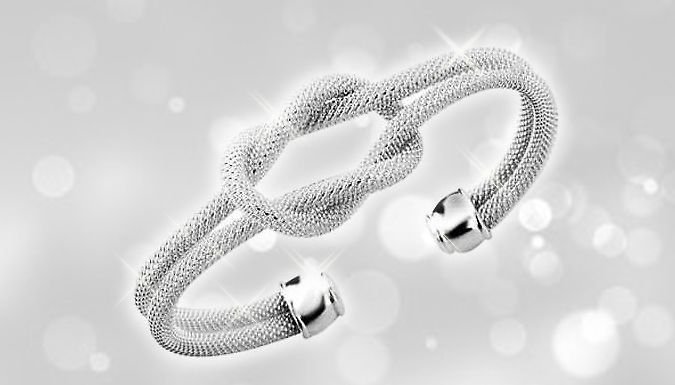 18K White Gold-Plated Knotted Bracelet Stun everyone with the beautiful 18K White Gold-Plated Knotted Bracelet      Double layered mesh design will catch the light      Stylish knot detailing will look fantastic      Comes presented in a black velvet pouch      Rounded end cuff detail will grip your wrist      A fantastic bracelet for both day and eveningwear      Tie up a super stylish look...