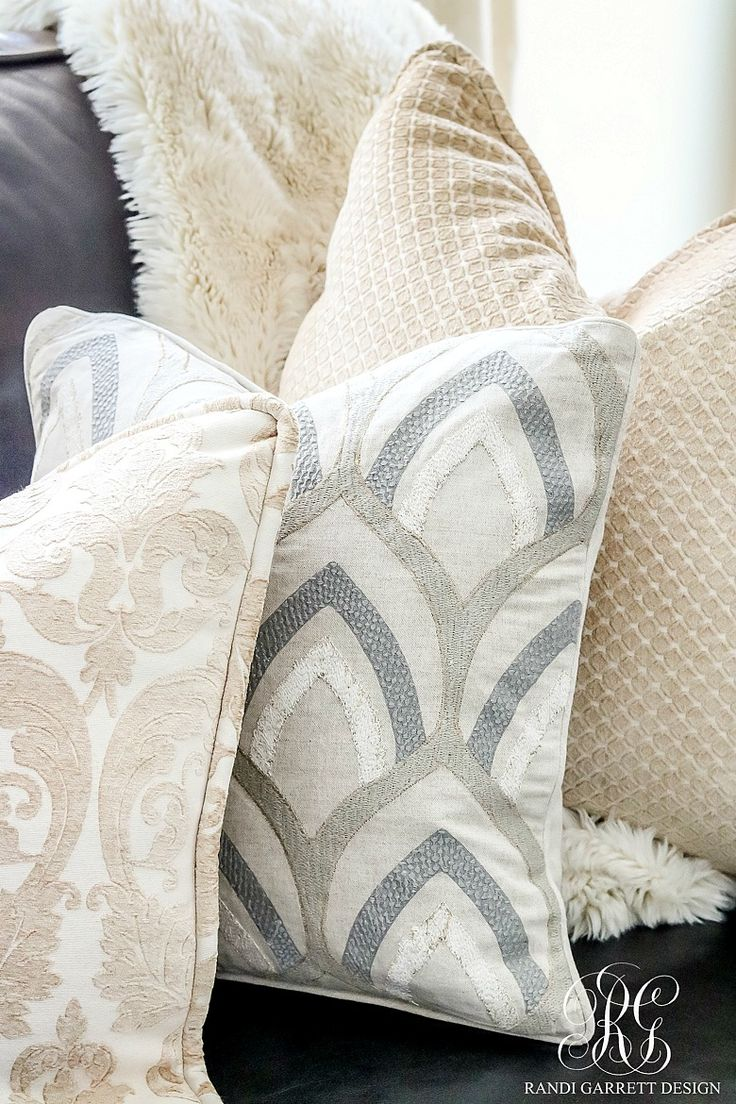 White, cream, gray, patterned pillows in family room decor. Soothing Summer Home Tour 2017 - Neutral Transitional Home Decor