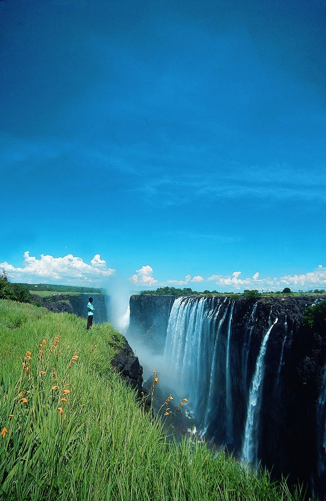 Victoria Falls, Zimbabwe The Victoria falls is 1 708 meters wide, making it the largest curtain of water in the world. It drops between 90m and 107m into the Zambezi Gorge and an average of 550,000 cubic metres of water plummet over the edge every minute.
