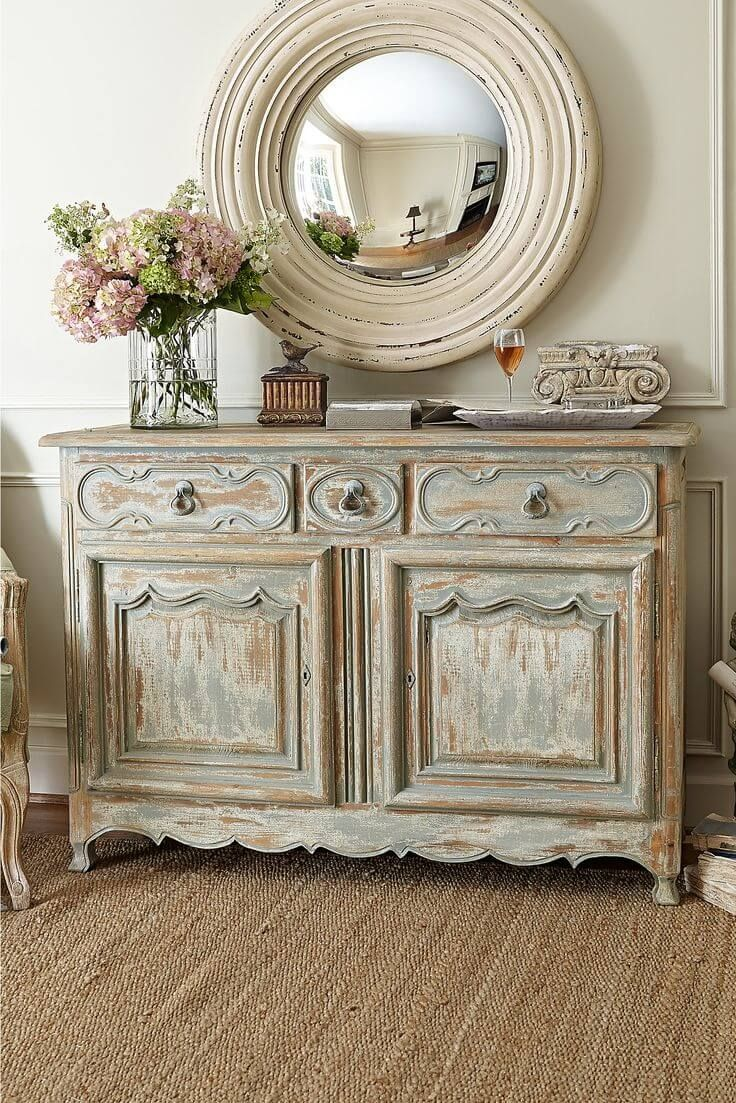 Antiqued Credenza and Rustic Round Mirror