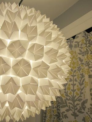 DIY: Ultra-cool paper lantern made by gluing origami shapes.