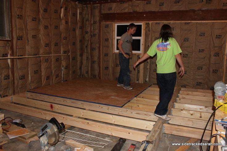 raise a sunken bedroom floor   The floor joists are going in.