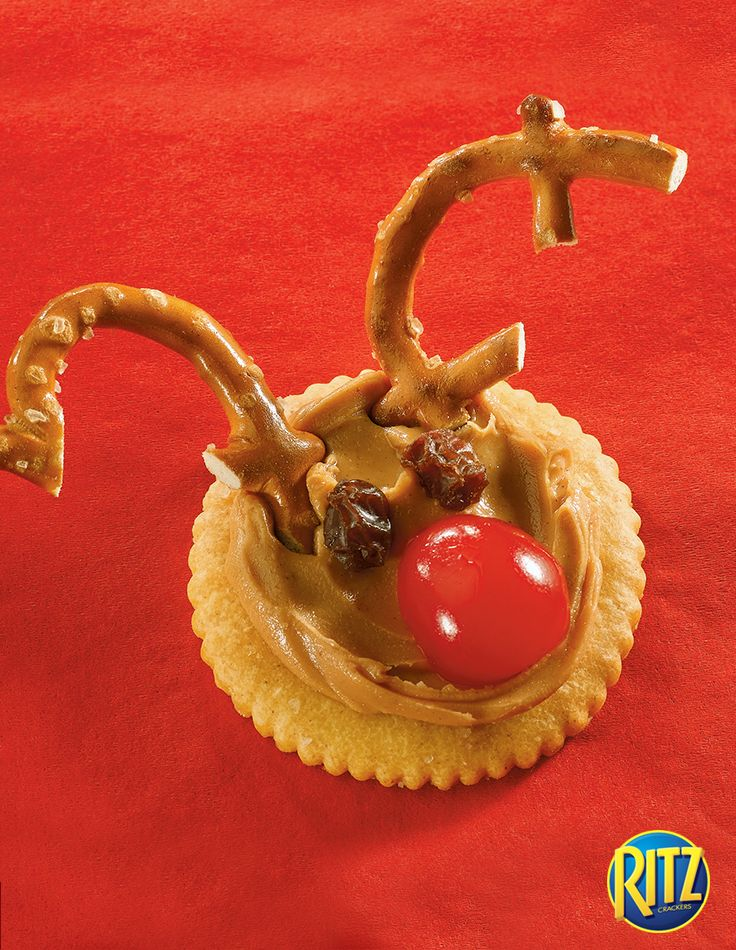 Create this adorable reindeer holiday treat with RITZ Crackers, pretzels, peanut butter, a maraschino cherry, and raisins!