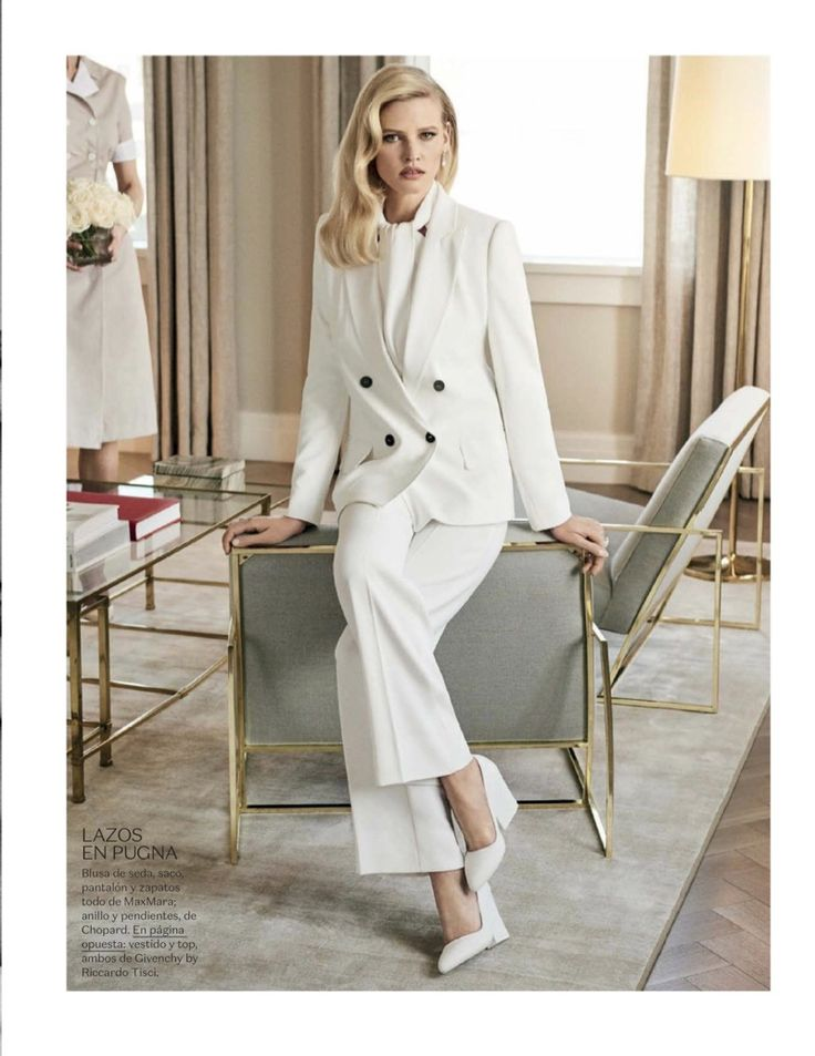Suiting up, Lara Stone models Max Mara jacket, blouse, pants and heels
