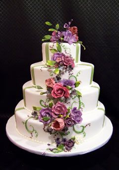White wedding cake purple & red flowers cascading