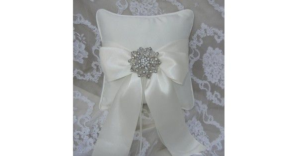 Satin Ring Bearer Pillow With Satin Ribbon & Crystal BroochOne Classic Weddingis pleased to offer this elegantsatin ring bearer pillow. Withit's oversized bow and glamourouscrystal encrusted brooch, this ring bearer pillowis the perfectwedding accessory