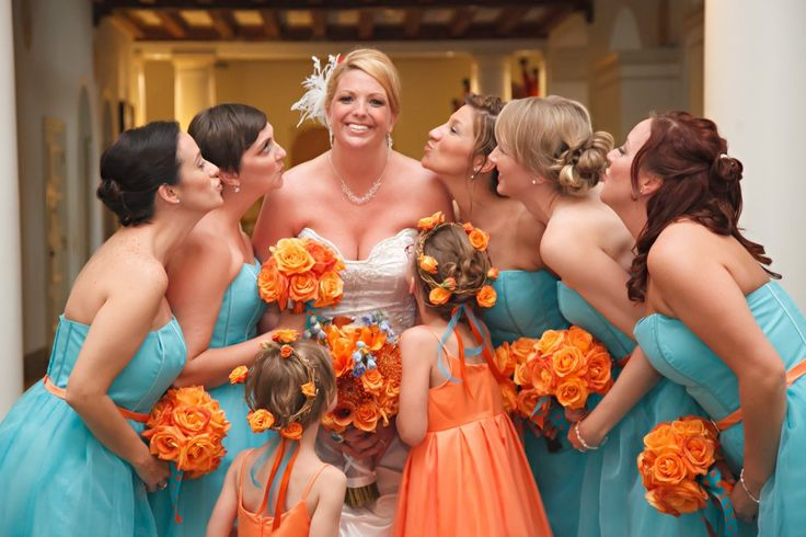 Bridesmaids and flower girls in turquoise and orange {via marrymetampabay.com} - see more at http://themerrybride.org/2014/07/19/turquoise-and-orange-wedding/