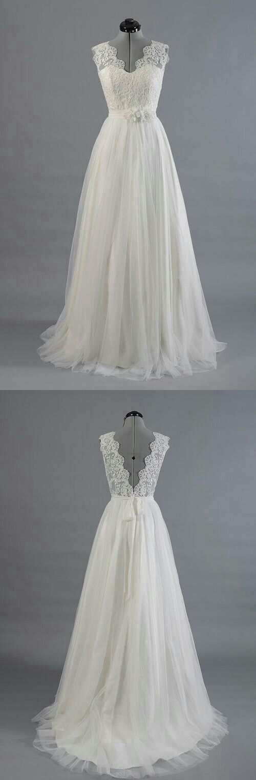 White wedding gown with lace bodice and banded detail in the waist with a flow skirt.