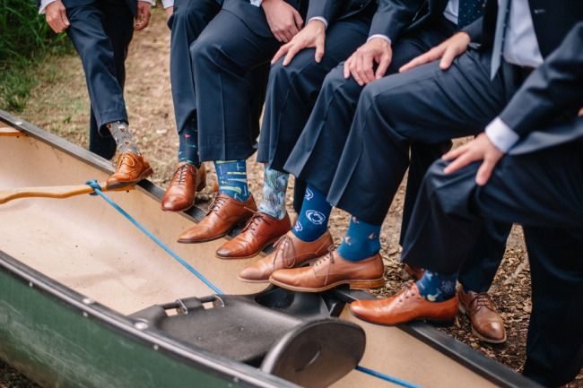 groomsmen show fun socks with brown shoes