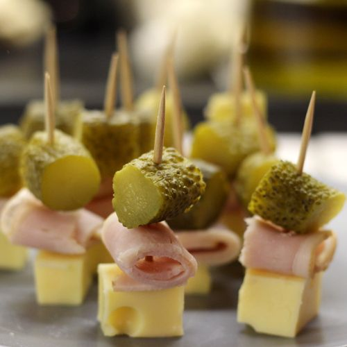 7 Cubes Swiss Cheese - 120 Calories 7 pieces Diced Pickle - 5 Calories 3 Slices Ham - 210 Calories: 335 Calories for 7 Skewers