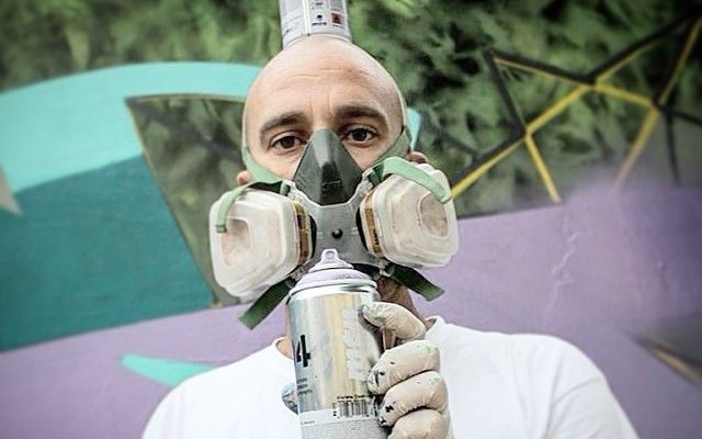 Umberto Koso Posing with spray cans Naples