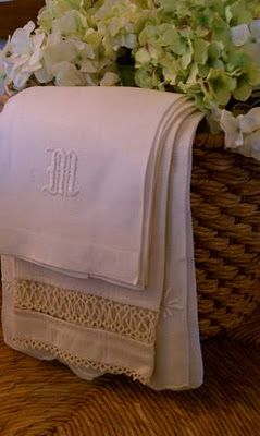Basket of monogrammed vintage linens.  Still relatively easy to find and affordable compared to ordering newly monogrammed linens.