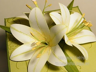 Paper lilies! Maybe This could be done with scissors rather than paper punches if you were careful...
