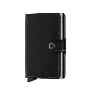 Secrid Original Black Secrid Mini Wallet: The Cardprotector is the secure heart of the SECRID wallet. With one simple movement, your cards slide out of the Cardprotector in a neat fan meaning that, even without opening your wallet, you can find the card you are looking for at a single glance.  The smooth leather jacket of the SECRID wallets envelopes the Cardprotector and offers space for extra cards. You can put paper money, receipts and business cards in the thin, but strong, plastic…