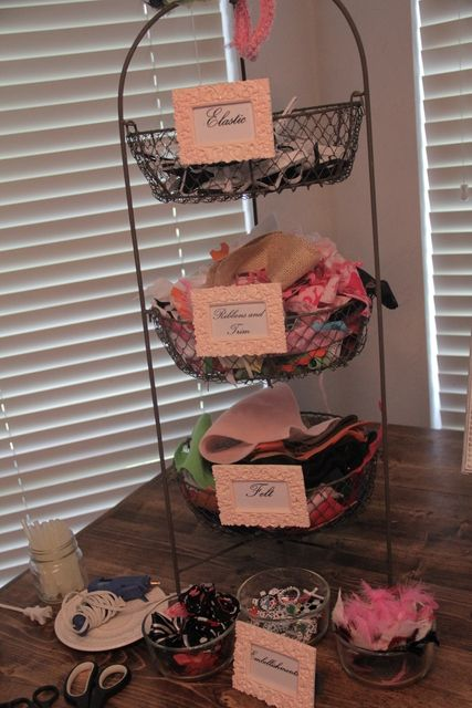 Guests create a headband or bow at a baby shower for a little girl.