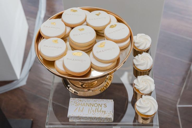 Event biscuits, themed in white  gold and imprinted... Celebrating Shannon's 21st Birthday  Sometimes it's the small touches that make for the best event styling.