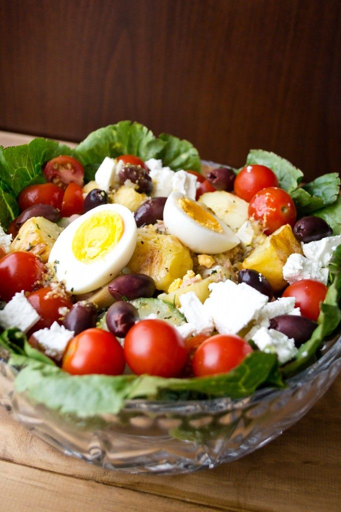 Mediterranean Salad with tuna, boiled eggs, roasted potatoes, olives and feta. A complete meal!