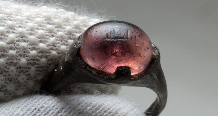 More than a century after its discovery in a ninth century woman's grave, an engraved ring has revealed evidence of close contacts between Viking Age Scandinavians and the Islamic world.
