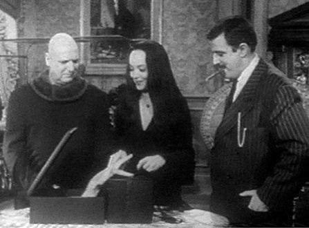 Jackie Coogan as Uncle Fester, Carolyn Jones as Morticia and.... The Adams Family