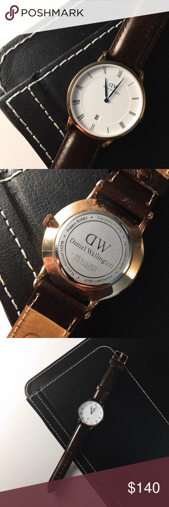 Daniel Wellington SALE ✨✨ Watch has only been worn once. It is brand new with no scratches on the glass.    This 38 mm watch from the Dapper Collection is rose gold and has been enriched with deep blue hands, Roman numerals and date with the brown St Mawes leather strap, made from Italian leather, and completes the look of a timeless and sophisticated watch.  PRICE IS FINAL 🔥 Daniel Wellington Accessories Watches