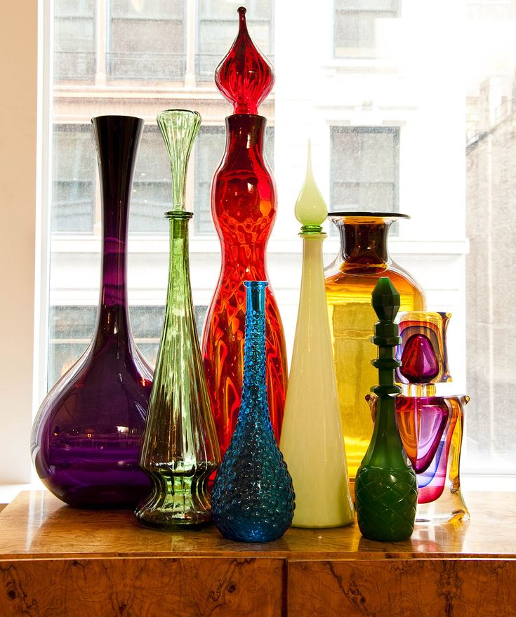 Over the years, I've been drawn to these colorful glass bottles and, before I knew it, I had suddenly filled a whole shelf. Some of them are Blenko glass, which I later learned are collector's items, and the one on the far right is an Onesto.