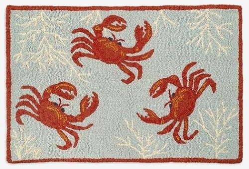 Prancing Crabs Hand Hooked Wool Accent Rug has subtle colors, to match your beachside retreat.