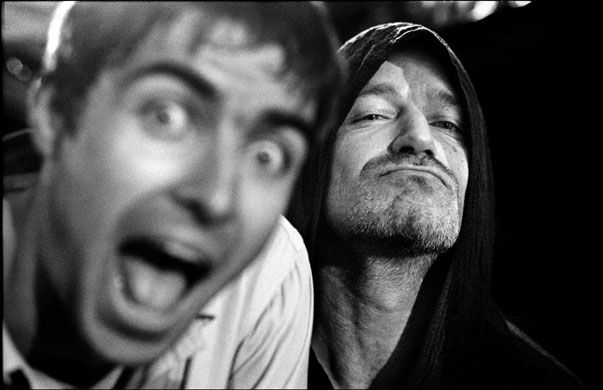 June 1997, San Francisco, USA: Oasis were supporting U2 on their Zooropa tour. Noel was singing Don't Look Back In Anger and Liam was watching him intently on a monitor on the side of the stage. I was shooting portraits of him, when suddenly a monk-like figure in a cowl loomed up on his right. I quickly changed focus to this figure and took one of my favourite images ever, of Liam and Bono (Photograph: Jill Furmanovsky) #u2newsactualite #bono #theedge #larrymullen #adamclayton #u2 #music…