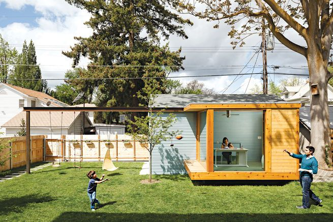 """We wanted to open up the back of the house, but there's nothing to look at,"" says Dana Zuckerman, who along with her husband and architects renovated a historic home in Boise, Idaho. ""So we decided to put something in our yard as a focal point, to create our own view."" The architects came up with a glass-walled studio, which Dana uses as her home office. The architects mounted a steel I-beam that spans the yard, with holes drilled at eight-inch intervals for maximum flexibility of use. ..."